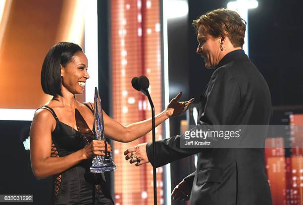 Actor Johnny Depp accepts an award from actress Jada Pinkett Smith onstage during the People's Choice Awards 2017 at Microsoft Theater on January 18...