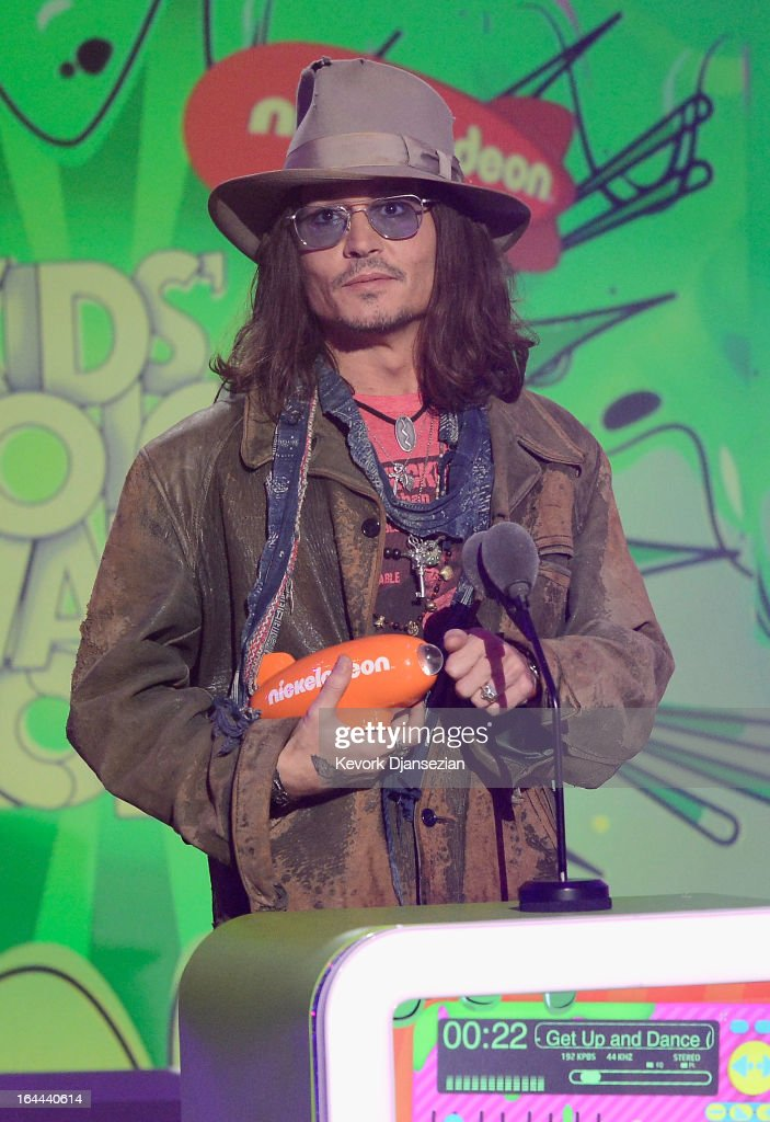 Actor <a gi-track='captionPersonalityLinkClicked' href=/galleries/search?phrase=Johnny+Depp&family=editorial&specificpeople=202150 ng-click='$event.stopPropagation()'>Johnny Depp</a> accepts Favorite Movie Actor award for 'Dark Shadows' onstage during Nickelodeon's 26th Annual Kids' Choice Awards at USC Galen Center on March 23, 2013 in Los Angeles, California.