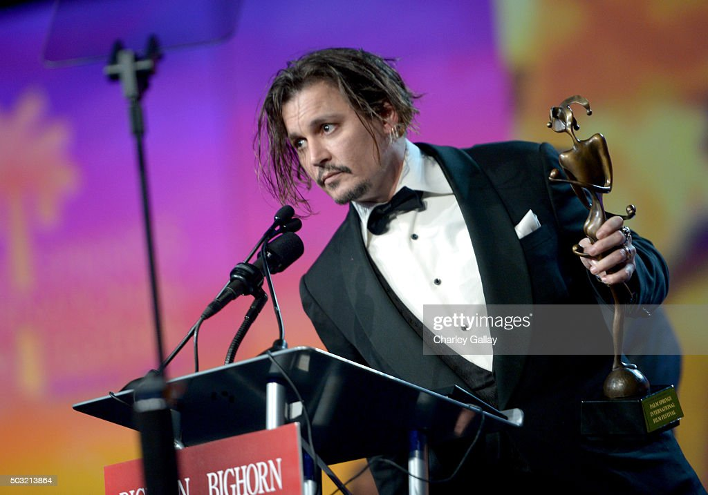 Actor Johnny Depp accepts the Desert Palm Achievement Award onstage at the 27th Annual Palm Springs International Film Festival Awards Gala at Palm...
