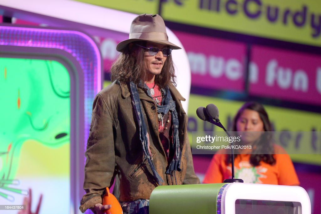 Actor <a gi-track='captionPersonalityLinkClicked' href=/galleries/search?phrase=Johnny+Depp&family=editorial&specificpeople=202150 ng-click='$event.stopPropagation()'>Johnny Depp</a> accepts the Kids' Choice Award for Favorite Movie Actor onstage during Nickelodeon's 26th Annual Kids' Choice Awards at USC Galen Center on March 23, 2013 in Los Angeles, California.