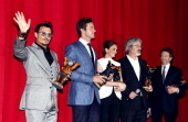 Actor Johnny Depp actor Armie Hammer actress Ruth Wilson director Gore Verbinski and producer Jerry Bruckheimer receive a 'Lone Ranger Berlin Bear'...