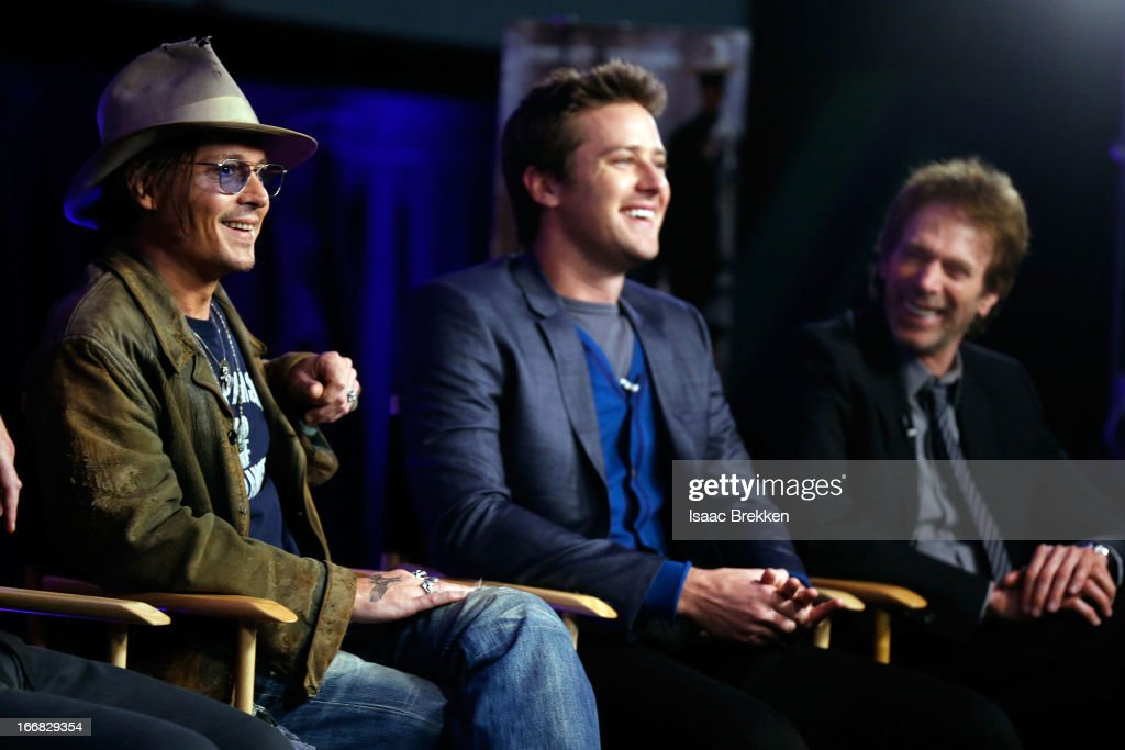 Actor Johnny Depp actor Armie Hammer and producer Jerry Bruckheimer attend 'The Lone Ranger' fan event and global trailer launch at the AMC Town...