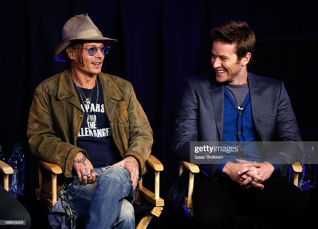 Actor <a gi-track='captionPersonalityLinkClicked' href=/galleries/search?phrase=Johnny+Depp&family=editorial&specificpeople=202150 ng-click='$event.stopPropagation()'>Johnny Depp</a> (L) and actor <a gi-track='captionPersonalityLinkClicked' href=/galleries/search?phrase=Armie+Hammer&family=editorial&specificpeople=5313113 ng-click='$event.stopPropagation()'>Armie Hammer</a> attend 'The Lone Ranger' fan event and global trailer launch at the AMC Town Square 18 theatres on April 17, 2013 in Las Vegas, Nevada.