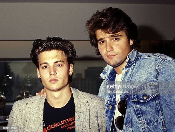 Actor Johnny Depp and actor Peter DeLuise attend the FOX Television Unveils New Primetime Schedule on June 3 1987 at the UN Plaza Hotel in New York...