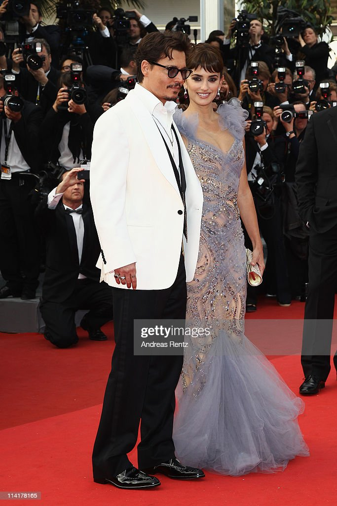 Actor <a gi-track='captionPersonalityLinkClicked' href=/galleries/search?phrase=Johnny+Depp&family=editorial&specificpeople=202150 ng-click='$event.stopPropagation()'>Johnny Depp</a> and actress Penelope Cruz attend the 'Pirates of the Caribbean: On Stranger Tides' premiere at the Palais des Festivals during the 64th Cannes Film Festival on May 14, 2011 in Cannes, France.