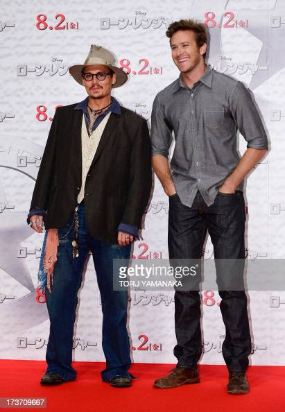 US actor Johnny Depp and Armie Hammer pose for photographers during a photo session to promote their latest movie 'the Lone Ranger' in Tokyo on July...