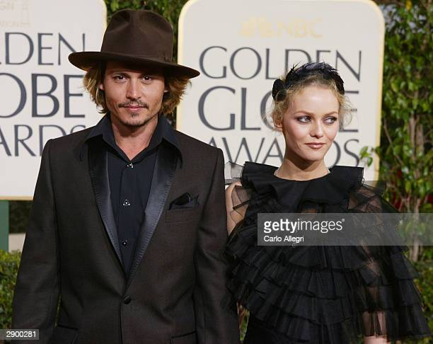 Actor Johnny Depp and Girlfriend Vanessa Paradis attend the 61st Annual Golden Globe Awards at the Beverly Hilton Hotel on January 25 2004 in Beverly...
