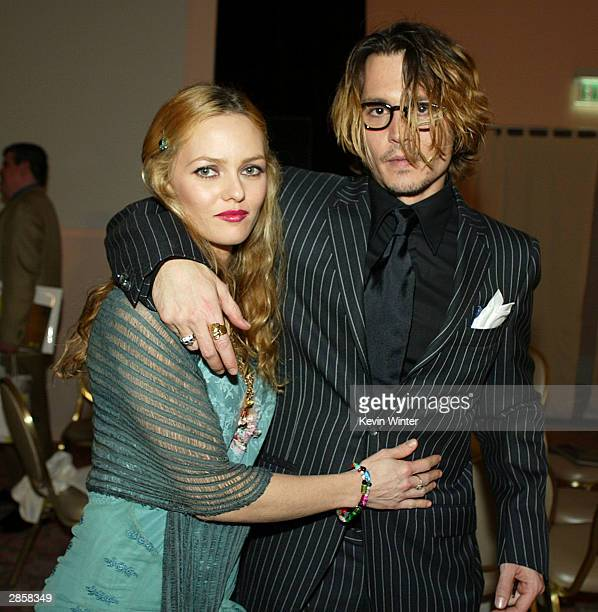 Actor Johnny Depp and girlfriend Vanessa Paradis pose after The 9th Annual Critic's Choice Awards at the Beverly Hills Hotel on January 10 2004 in...