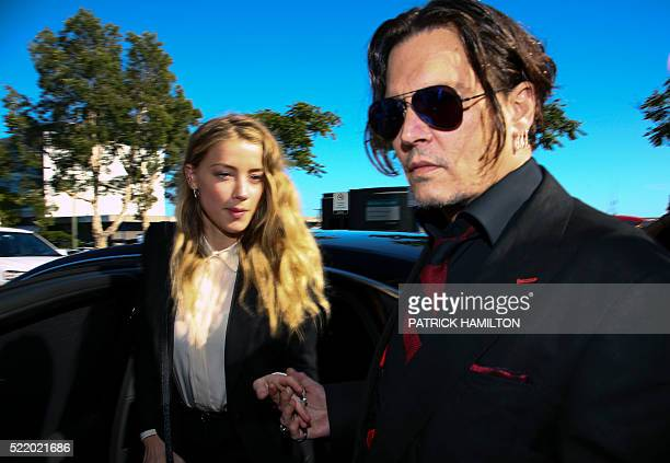 US actor Johnny Depp and his wife Amber Heard arrive at a court in the Gold Coast on April 18 2016 Depp and Heard arrived at an Australian court...