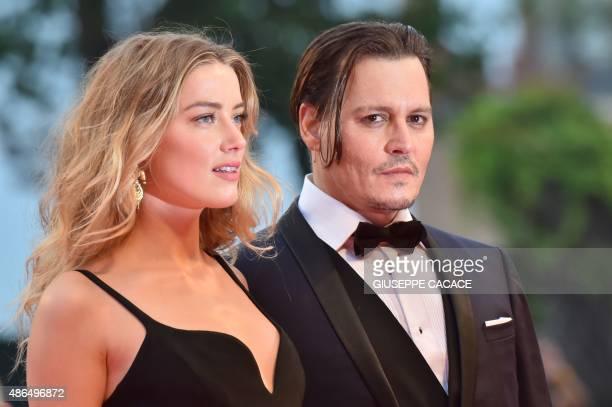 US actor Johnny Depp and his wife US actress Amber Heard arrive for screening of the movie 'Black Mass' presented out of competition at the 72nd...