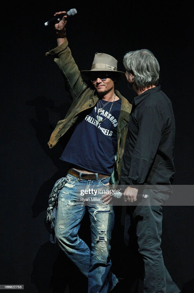 Actor Johnny Depp and Lone Ranger Director and Producer Gore Verbinski speak onstage during The Walt Disney Studios Invites You to an Exclusive...