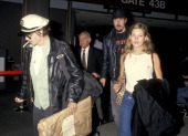 Actor Johnny Depp and model Kate Moss arrive from New York City on February 21 1994 at Los Angeles International Airport in Los Angeles California