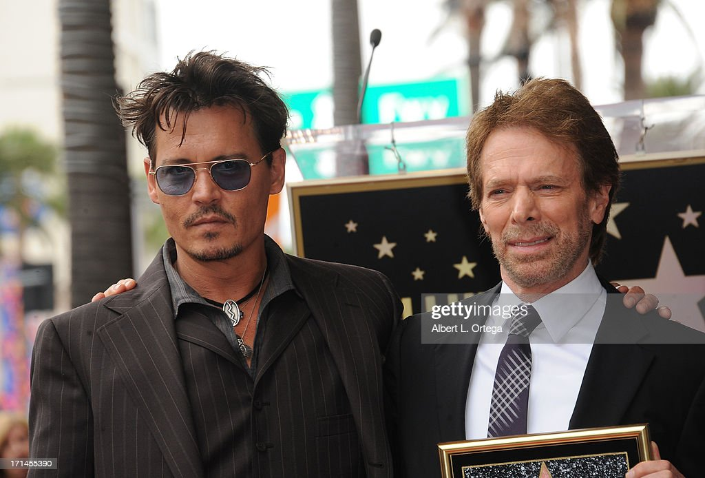 Actor Johnny Depp and producer Jerry Bruckheimer attend the Jerry Bruckheimer Star On The Hollywood Walk Of Fame on June 24, 2013 in Hollywood, California.