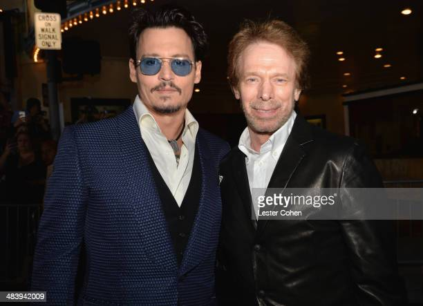 Actor Johnny Depp and producer Jerry Bruckheimer attend the premiere of Warner Bros Pictures and Alcon Entertainment's 'Transcendence' at Regency...
