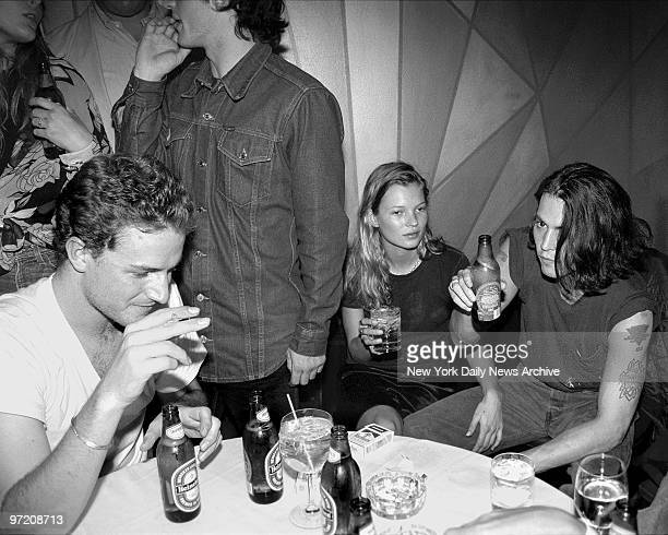 Actor Johnny Depp and supermodel Kate Moss his girlfriend of the moment sit together at the thirtyeighth birthday party thrown by Depp for fellow...