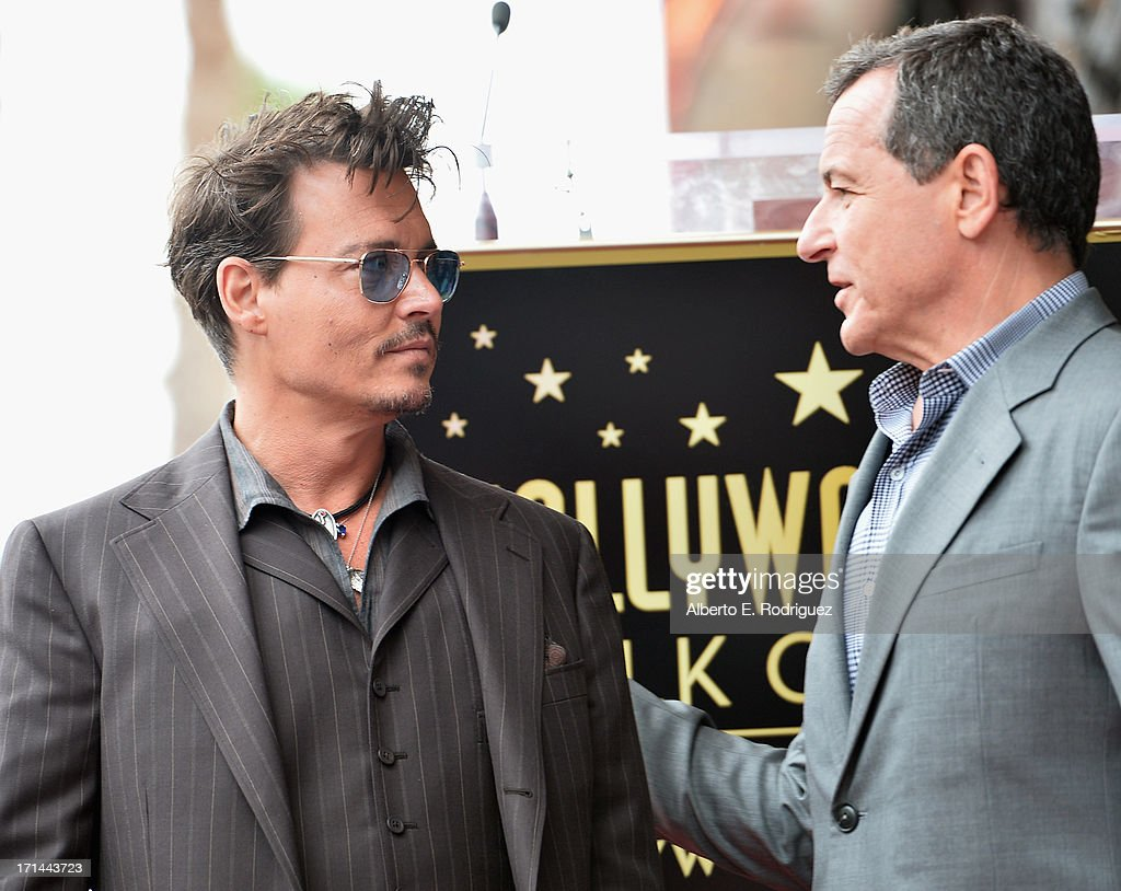 Actor Johnny Depp and The Walt Disney Company Chairman and CEO Bob Iger attend Legendary Producer Jerry Bruckheimer Hollywood Walk of Fame Star Ceremony on the Hollywood Walk of Fame on June 24, 2012 in Hollywood, California.