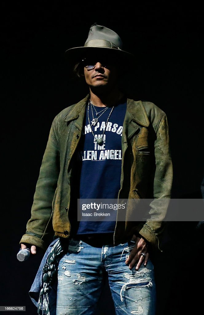Actor <a gi-track='captionPersonalityLinkClicked' href=/galleries/search?phrase=Johnny+Depp&family=editorial&specificpeople=202150 ng-click='$event.stopPropagation()'>Johnny Depp</a> appears at The Walt Disney Studios Motion Pictures presentation to promote his upcoming film, 'The Lone Ranger' at Caesars Palace during CinemaCon, the official convention of the National Association of Theatre Owners on April 17, 2013 in Las Vegas, Nevada.