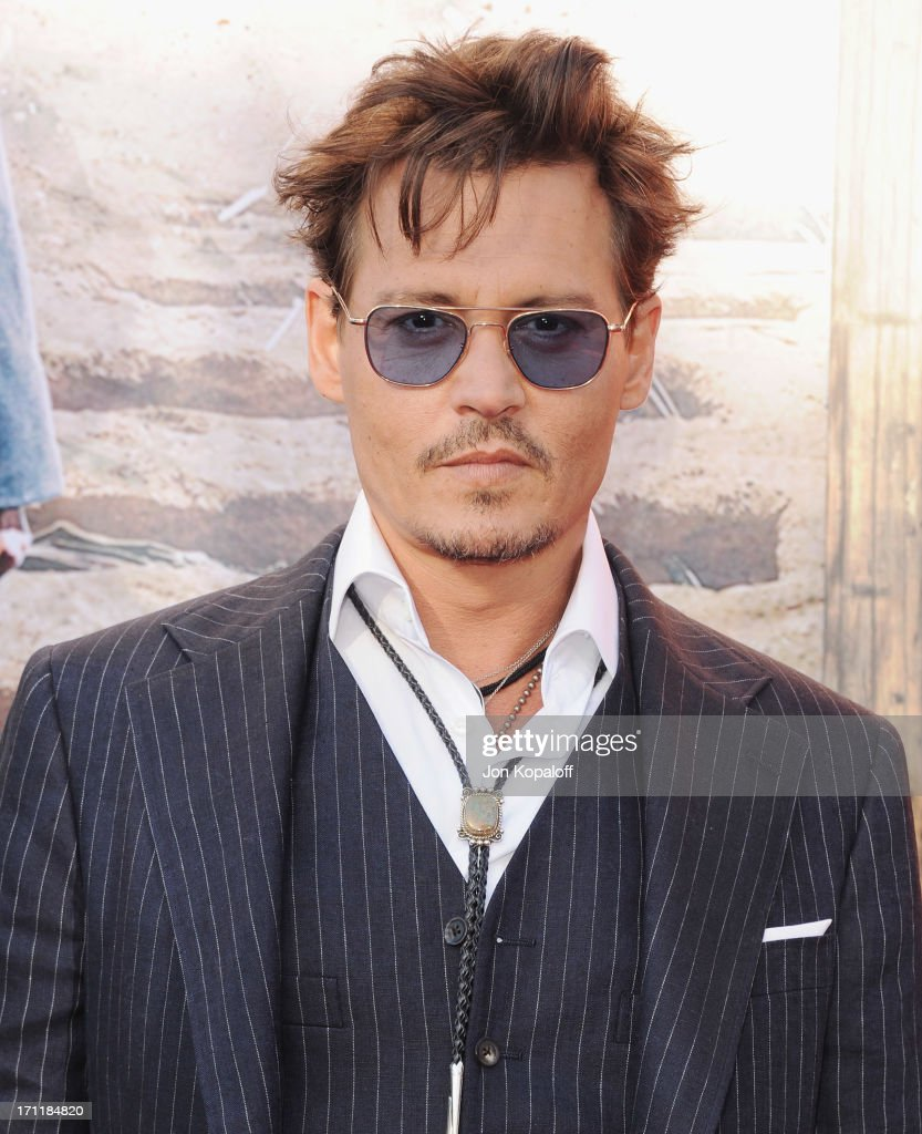Actor <a gi-track='captionPersonalityLinkClicked' href=/galleries/search?phrase=Johnny+Depp&family=editorial&specificpeople=202150 ng-click='$event.stopPropagation()'>Johnny Depp</a> arrives at the Los Angeles premiere 'The Lone Ranger' at Disney California Adventure Park on June 22, 2013 in Anaheim, California.