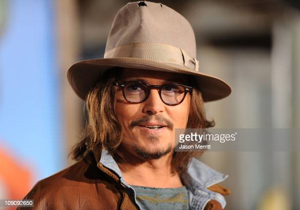 Actor Johnny Depp arrives at the premiere of Paramount Pictures' 'Rango' at Regency Village Theater on February 14 2011 in Los Angeles California