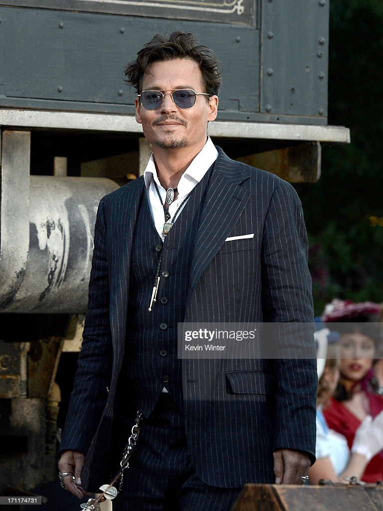 Actor <a gi-track='captionPersonalityLinkClicked' href=/galleries/search?phrase=Johnny+Depp&family=editorial&specificpeople=202150 ng-click='$event.stopPropagation()'>Johnny Depp</a> arrives at the premiere of Walt Disney Pictures' 'The Lone Ranger' at Disney California Adventure Park on June 22, 2013 in Anaheim, California.