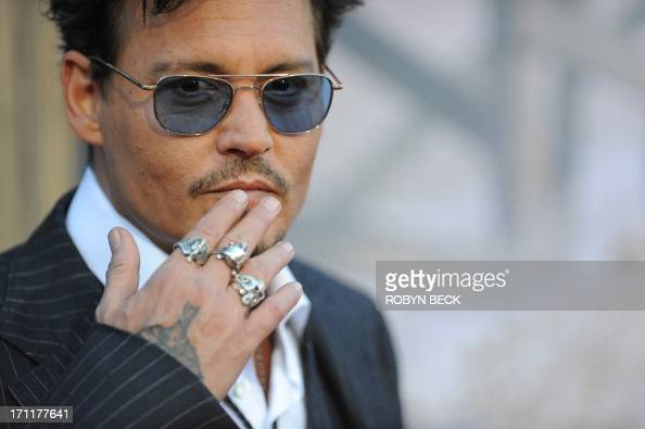 Actor Johnny Depp arrives for the world premiere of 'The Lone Ranger' at Disney California Adventure in Anaheim California June 22 2013 AFP PHOTO /...