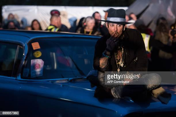 TOPSHOT Actor Johnny Depp arrives to introduce his film The Libertine to the audience at 'Cineramageddon' the outdoor cinema venue at the Glastonbury...