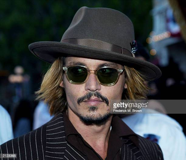 Actor Johnny Depp attends the film premiere of 'Pirates of the Caribbean' at Disneyland on June 28 2003 in Anaheim California