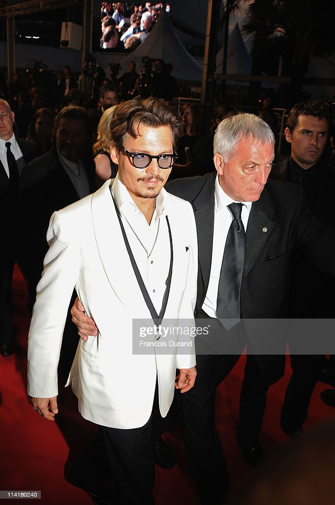 Actor <a gi-track='captionPersonalityLinkClicked' href=/galleries/search?phrase=Johnny+Depp&family=editorial&specificpeople=202150 ng-click='$event.stopPropagation()'>Johnny Depp</a> departs the 'Pirates of the Caribbean: On Stranger Tides' premiere at the Palais des Festivals during the 64th Cannes Film Festival on May 14, 2011 in Cannes, France.
