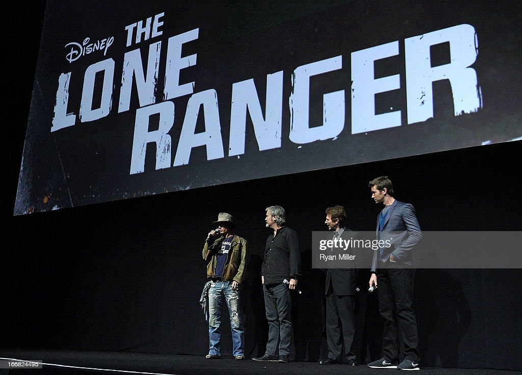Actor Johnny Depp director and producer Gore Verbinski producer Jerry Bruckheimer and actor Armie Hammer speak onstage during The Walt Disney Studios...