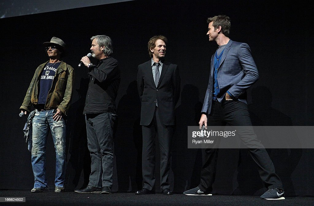 Actor Johnny Depp, director and producer Gore Verbinski, producer Jerry Bruckheimer and actor Armie Hammer speak onstage during The Walt Disney Studios Invites You to an Exclusive Presentation Highlighting the Summer of 2013 - Including a Special Screening of Disney-Pixar's 'Monsters University' at Caesars Palace during CinemaCon, the official convention of the National Association of Theatre Owners on April 17, 2013 in Las Vegas, Nevada.