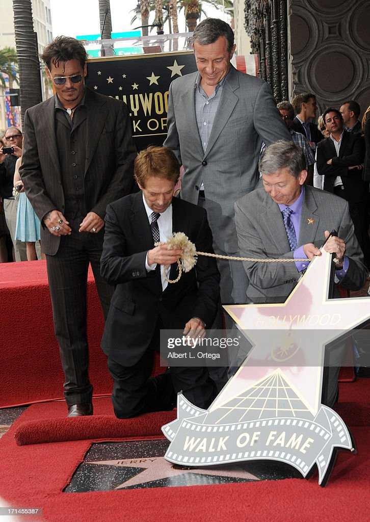 Actor Johnny Depp, Disney executive Bob Iger, producer Jerry Bruckheimer and WOH CEO Leron Gubler attend the Jerry Bruckheimer Star On The Hollywood Walk Of Fame on June 24, 2013 in Hollywood, California.