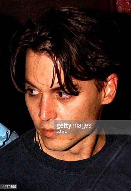 Actor Johnny Depp leaves the after party of the premiere of 'Lost In La Mancha' on July 25 2002 in London England