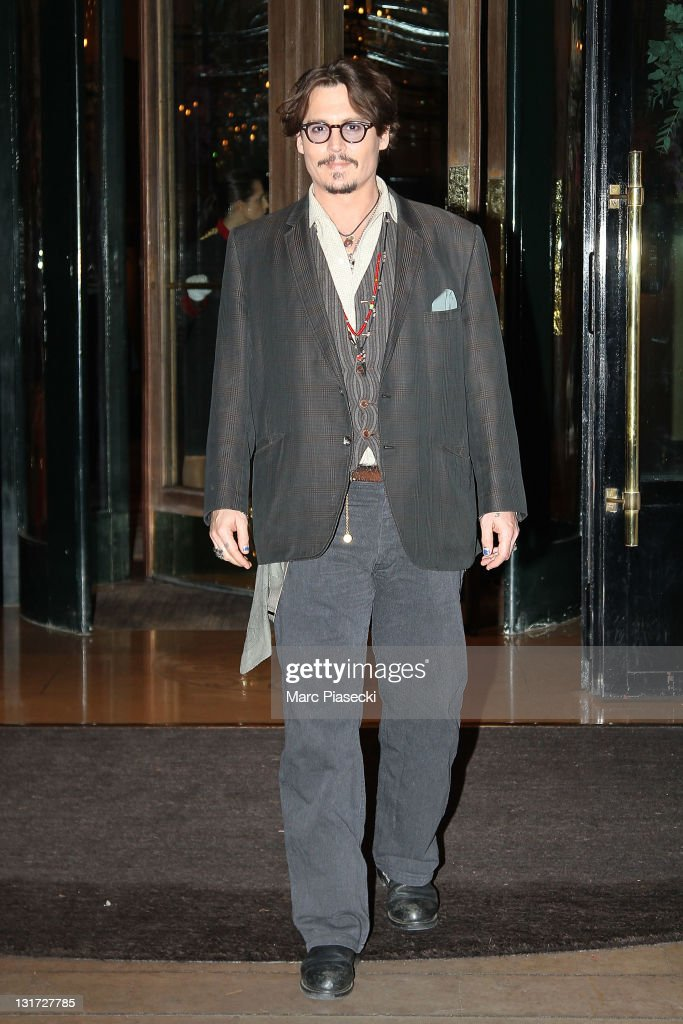 Actor Johnny Depp leaves the 'Plaza Athenee' hotel on November 7 2011 in Paris France