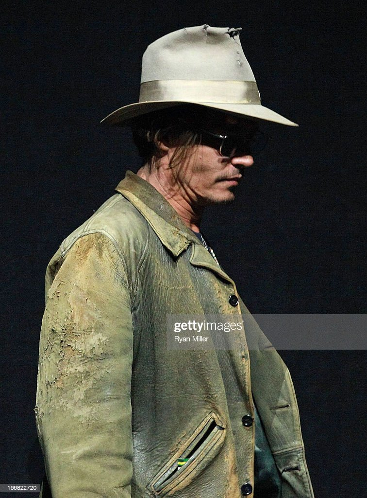Actor <a gi-track='captionPersonalityLinkClicked' href=/galleries/search?phrase=Johnny+Depp&family=editorial&specificpeople=202150 ng-click='$event.stopPropagation()'>Johnny Depp</a> onstage during The Walt Disney Studios Invites You to an Exclusive Presentation Highlighting the Summer of 2013 - Including a Special Screening of Disney-Pixar's 'Monsters University' at Caesars Palace during CinemaCon, the official convention of the National Association of Theatre Owners on April 17, 2013 in Las Vegas, Nevada.