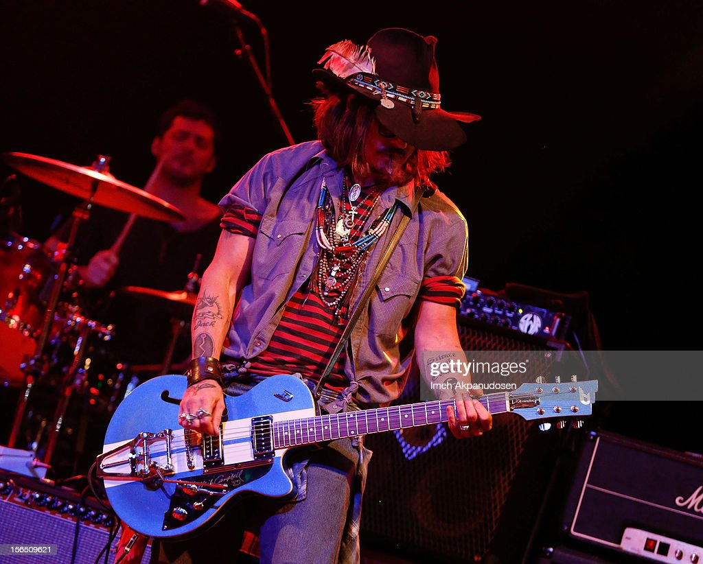 Actor <a gi-track='captionPersonalityLinkClicked' href=/galleries/search?phrase=Johnny+Depp&family=editorial&specificpeople=202150 ng-click='$event.stopPropagation()'>Johnny Depp</a> performs as a guest guitarist onstage during the first ever Jameson Petty Fest West at El Rey Theatre on November 15, 2012 in Los Angeles, California.