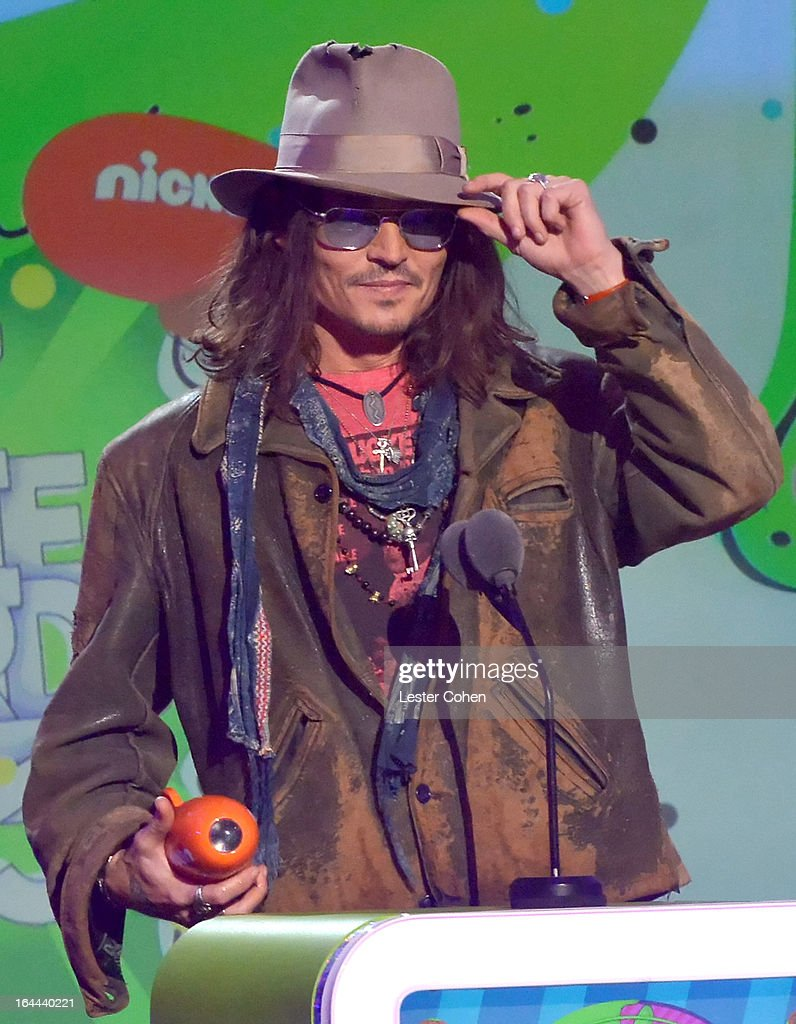 Actor <a gi-track='captionPersonalityLinkClicked' href=/galleries/search?phrase=Johnny+Depp&family=editorial&specificpeople=202150 ng-click='$event.stopPropagation()'>Johnny Depp</a> performs during Nickelodeon's 26th Annual Kids' Choice Awards at USC Galen Center on March 23, 2013 in Los Angeles, California.
