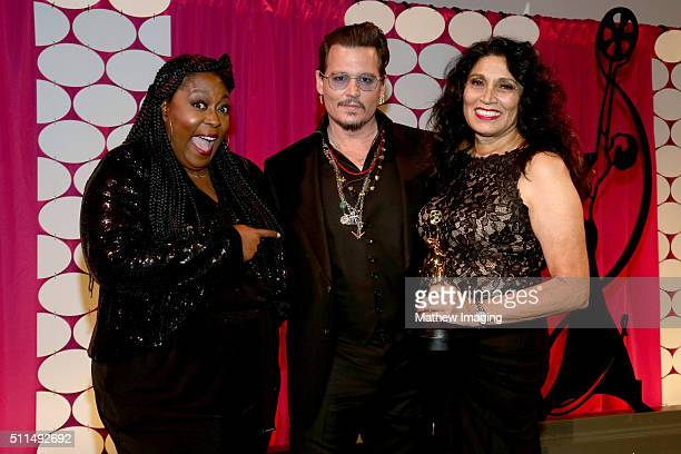Actor Johnny Depp poses backstage with TV personality Loni Love and Lifetime Achievement Honoree Yolanda Toussieng at the MakeUp Artists and Hair...