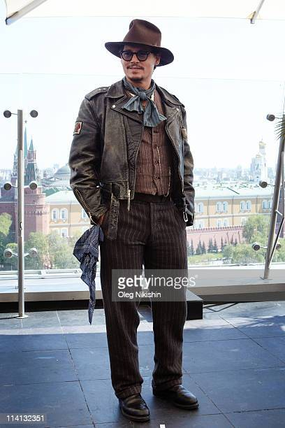 Actor Johnny Depp poses for a photocall before the Russian premiere of the film 'Pirates Of The Caribbean On Stranger Tides' on the roof of the Ritz...