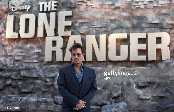 US actor Johnny Depp poses for pictures on the red carpet for the UK premier of the film 'The Lone Ranger' in Leicester Square central London on July...