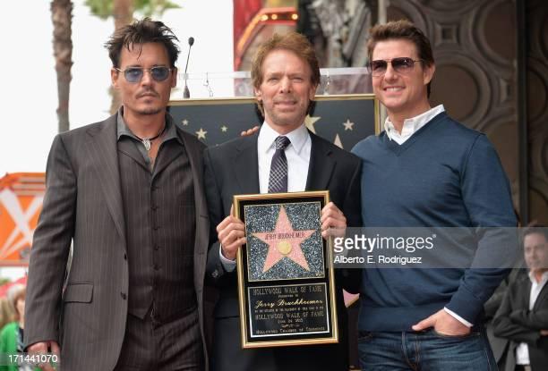 Actor Johnny Depp producer Jerry Bruckheimer and actor Tom Cruise attend Legendary Producer Jerry Bruckheimer Hollywood Walk of Fame Star Ceremony on...