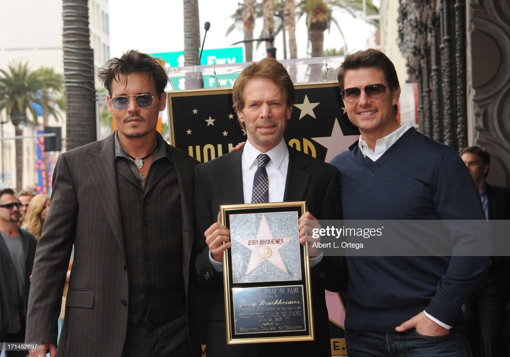 Actor Johnny Depp, producer Jerry Bruckheimer and actor Tom Cruise attend Jerry Bruckheimer's Hollywood Walk of Fame ceremony on June 24, 2013 in Hollywood, California.