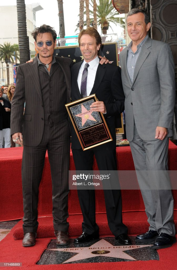 Actor Johnny Depp, producer Jerry Bruckheimer and Disney executive Bob Iger attend the Jerry Bruckheimer Star On The Hollywood Walk Of Fame on June 24, 2013 in Hollywood, California.