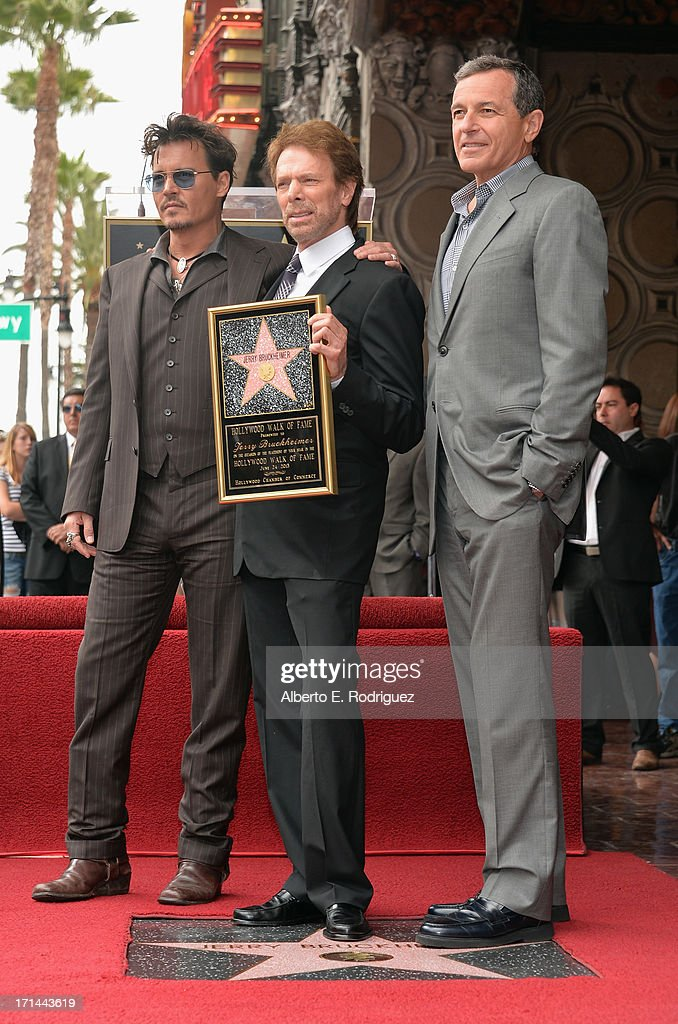 Actor Johnny Depp, producer Jerry Bruckheimer and The Walt Disney Company Chairman and CEO Bob Iger attend Legendary Producer Jerry Bruckheimer Hollywood Walk of Fame Star Ceremony on the Hollywood Walk of Fame on June 24, 2012 in Hollywood, California.