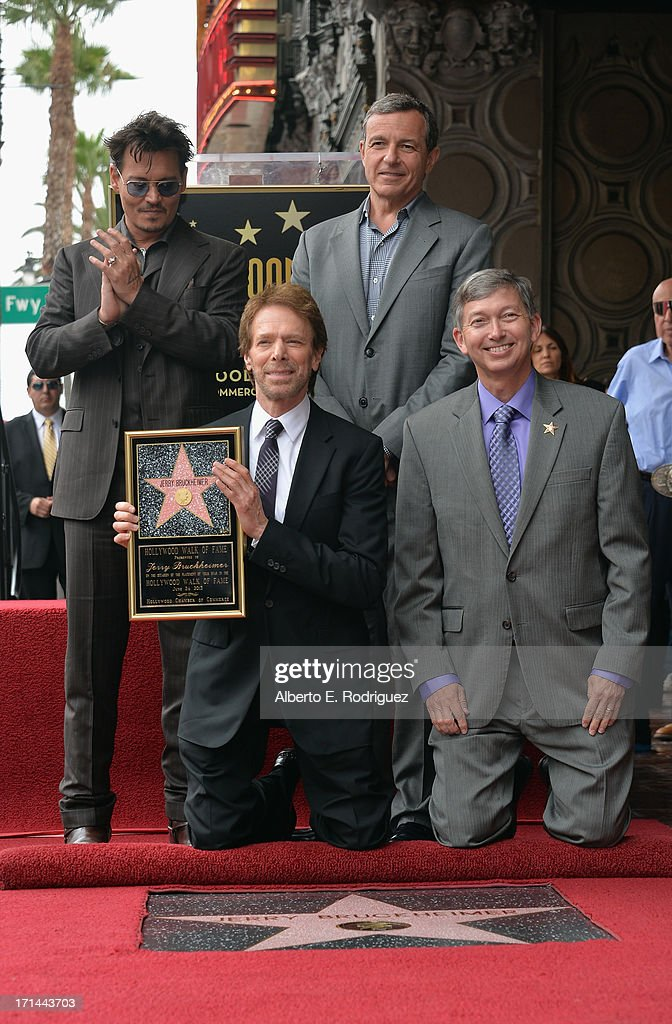 Actor Johnny Depp, producer Jerry Bruckheimer, The Walt Disney Company Chairman and CEO Bob Iger and Hollywood Chamber of Commerce President and CEO Leron Gubler attend Legendary Producer Jerry Bruckheimer Hollywood Walk of Fame Star Ceremony on the Hollywood Walk of Fame on June 24, 2012 in Hollywood, California.
