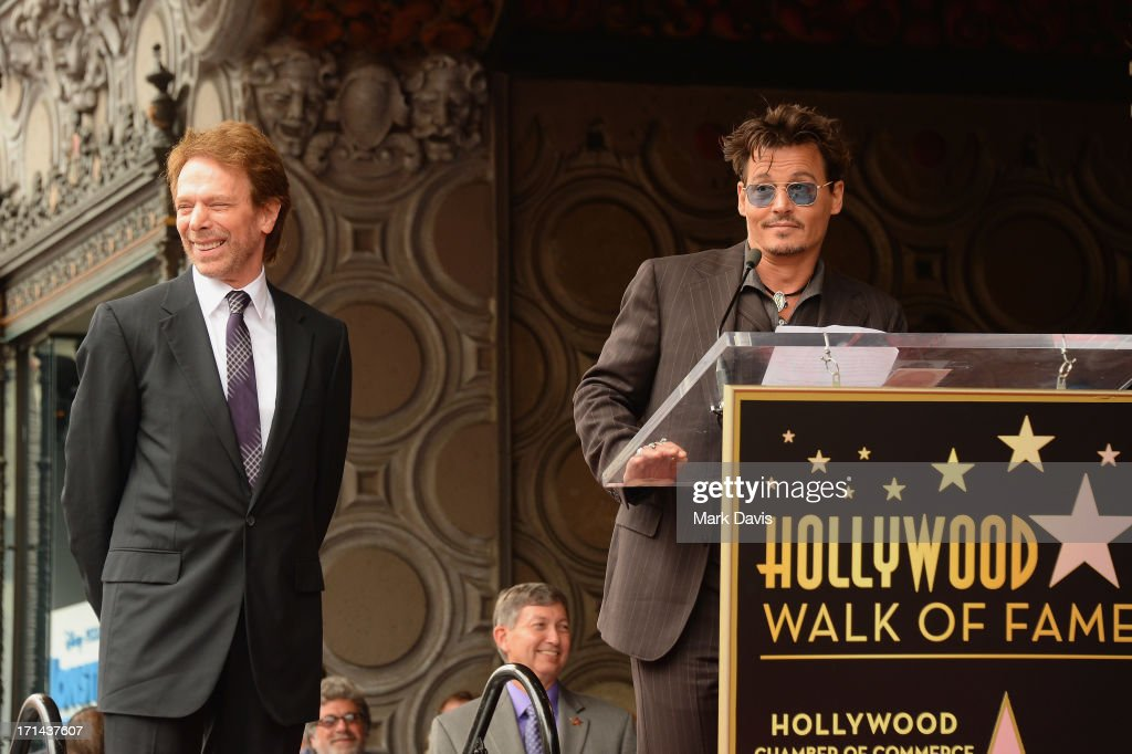 Actor Johnny Depp speaks as Jerry Bruckheimer is honored on the Hollywood Walk Of Fame on June 24 2013 in Hollywood California