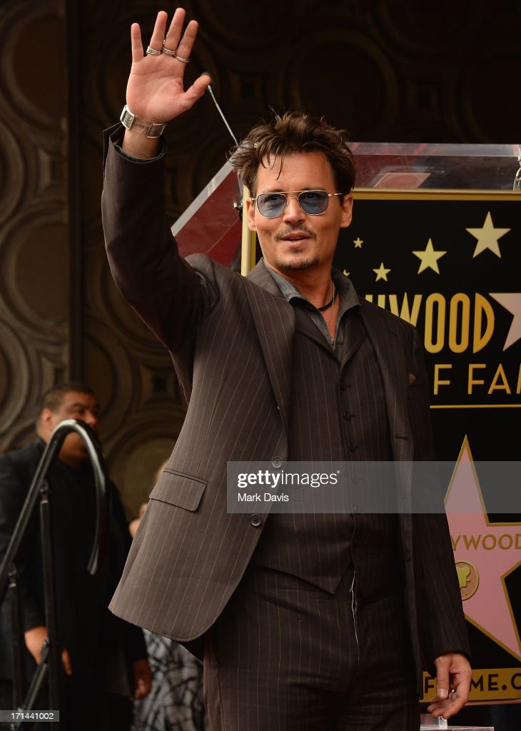 Actor <a gi-track='captionPersonalityLinkClicked' href=/galleries/search?phrase=Johnny+Depp&family=editorial&specificpeople=202150 ng-click='$event.stopPropagation()'>Johnny Depp</a> speaks as Jerry Bruckheimer is honored on the Hollywood Walk Of Fame on June 24, 2013 in Hollywood, California.