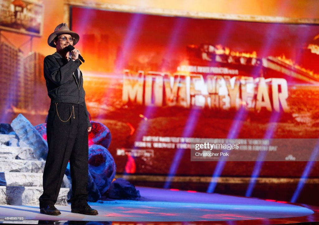 Actor <a gi-track='captionPersonalityLinkClicked' href=/galleries/search?phrase=Johnny+Depp&family=editorial&specificpeople=202150 ng-click='$event.stopPropagation()'>Johnny Depp</a> speaks onstage at the 2014 MTV Movie Awards at Nokia Theatre L.A. Live on April 13, 2014 in Los Angeles, California.