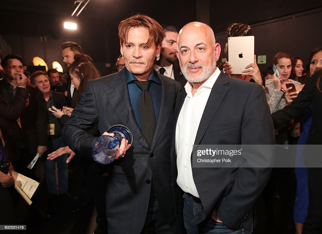 Actor Johnny Depp (L), winner of the Favorite Movie Icon award, and Executive Vice President, Specials, Music and Live Events, CBS Entertainment Jack Sussman pose backstage at the People's Choice Awards 2017 at Microsoft Theater on January 18, 2017 in Los Angeles, California.