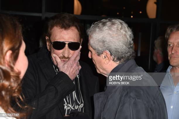 Actor Johnny Hallyday and director Claude Lellouch attend the premiere of 'Everyone's Life' on the opening night of COLCOA French Film Festival April...