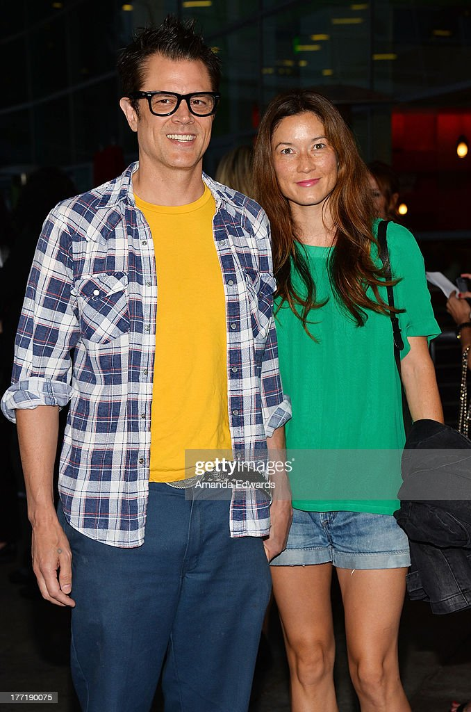 Actor Johnny Knoxville (L) and his wife Naomi Nelson arrive at the Los Angeles premiere of 'The World's End' at ArcLight Cinemas Cinerama Dome on August 21, 2013 in Hollywood, California.